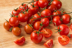Cherry tomatoes - water drops- wood background Stock Image