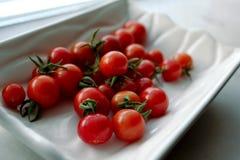 Cherry tomatoes. On a white background Royalty Free Stock Photos