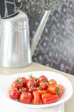 Cherry tomatoes. On a white plate Royalty Free Stock Photos