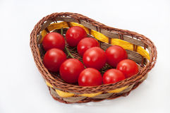Cherry tomatoes in a wicker basket Stock Photo
