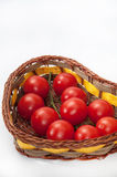 Cherry tomatoes in a wicker basket Stock Photography