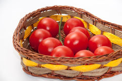 Cherry tomatoes in a wicker basket Royalty Free Stock Images