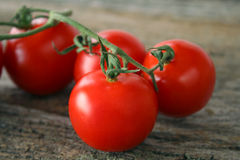 Cherry Tomatoes on Wood Royalty Free Stock Photography