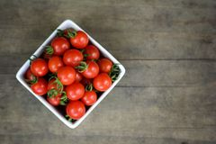 Cherry tomatoes on wood background Stock Image