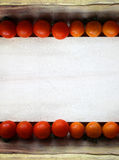 Cherry tomatoes on wood frame Royalty Free Stock Images