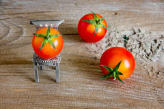 Cherry tomatoes. On the wooden background Stock Image