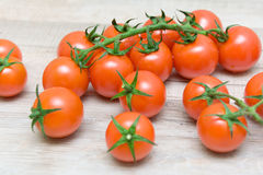 Cherry tomatoes on wooden background closeup Stock Photos