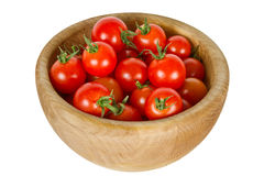 Cherry tomatoes in a wooden bowl Royalty Free Stock Images