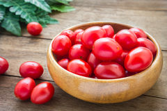 Cherry tomatoes in wooden bowl Royalty Free Stock Photo