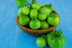 Cherry tomatoes  in wooden bowl Stock Images