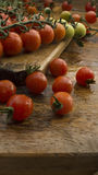 Cherry tomatoes on wooden chopping board and table. High resolution image Stock Photography