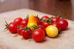 Cherry tomatoes on wooden cutting board Stock Image