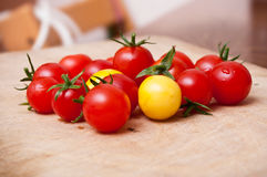Cherry tomatoes on wooden cutting board Royalty Free Stock Photo