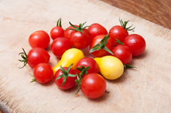 Cherry tomatoes on wooden cutting board Stock Photography