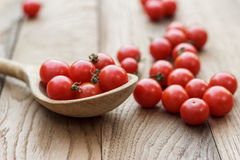 Cherry tomatoes and wooden spoon Stock Image