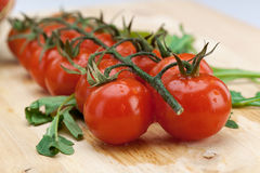 Cherry Tomatoes on Wooden Surface Stock Images