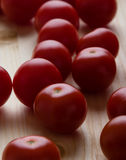 Cherry tomatoes on wooden table. Fresh raw red cherry tomatoes on wooden table Stock Photography