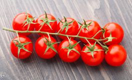 Cherry tomatoes on wooden table Stock Image