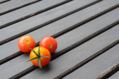Cherry tomatoes on a wooden table. Fresh vegetables Stock Photography