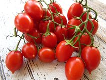Cherry tomatoes on wooden table, high angle view Stock Photo