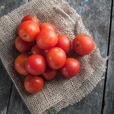 Cherry tomatoes on wooden table Royalty Free Stock Photo