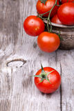 Cherry tomatoes on wooden table Royalty Free Stock Photos