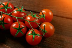 Cherry tomatoes on a worn brown wooden background place for text royalty free stock photography