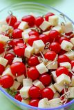 Cherry tomatoes and yellow cheese on wooden sticks appetizer Royalty Free Stock Photography