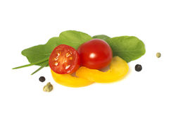 Cherry tomatoes, yellow pepper, herbs and spices Stock Photo