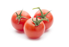 Cherry tomatos. Group of cherry tomatos isolated on white background Royalty Free Stock Photo