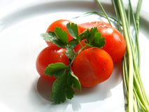 Cherry tomatos. On a plate Stock Images