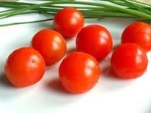Cherry tomatos. Fresh wet cherry tomatos Royalty Free Stock Images