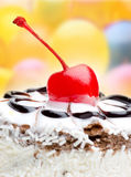 Cherry on top of a cake Stock Photos