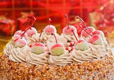 Cherry on top of ice cream cake Royalty Free Stock Photos