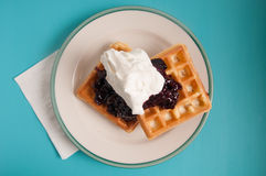 Cherry topped waffles and whipped cream Stock Image