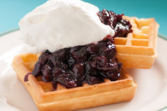 Cherry topped waffles and whipped cream Royalty Free Stock Photo