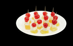 Cherry topping on pineapple cheese at shallow DOF Stock Images