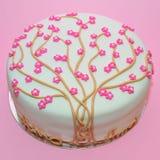 Cherry tree flowers cake. Pink flowers cherry tree fondant cake stock images