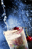 Cherry in water. Royalty Free Stock Photos