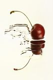 Cherry in water Royalty Free Stock Image