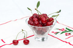 Cherry with water drops in the glass Stock Photography