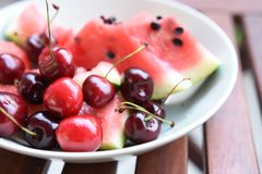 Cherry and watermelon in the plate stock photography