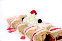 Cherry and Whipped Cream Topped Crepe Stock Photo