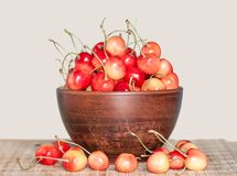 Cherry white berries in a clay plate Royalty Free Stock Image