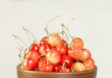 Cherry white berries in a clay plate Royalty Free Stock Photography