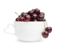 Cherry. In white bowl on white background stock image