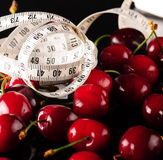 Cherry and white measurement Royalty Free Stock Photos