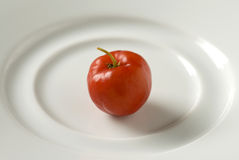 Cherry on white plate Stock Photos