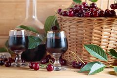 Free Cherry Wine Or Liquor And Ripe Juicy Cherries Stock Photo - 138183310