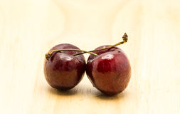 Cherry on wood Royalty Free Stock Photo